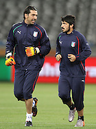 CAPE TOWN, SOUTH AFRICA - 13 JUNE 2010, Italian goalkeeper Gianluigi Buffon and Gennaro Gattuso of Italy chat while warming up during Italy's training session held at the Cape Town Stadium. Italy play Paraguay in Match 11 of the 2010 FIFA World Cup on Monday 14 June 2010. Photo by: Shaun Roy/Sportzpics