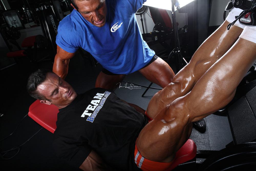 Bodybuilders Dan Decker and Brian Yersky doing leg presses.