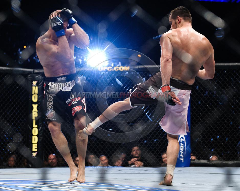 "ATLANTA, GEORGIA, SEPTEMBER 6, 2008: Matt Hamill (left) covers up from a kick by Rich Franllin during ""UFC 88: Breakthrough"" inside Philips Arena in Atlanta, Georgia on September 6, 2008"