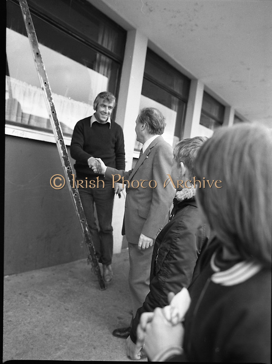 Taoiseach's Election Campaign.      (N77)..1981..23.05.1981..05.23.1981..23rd May 1981..On the 21st May the Taoiseach, Mr Charles Haughey, dissolved the Dáil and called a general election. Charles Haughey, Garret Fitzgerald and Frank Cluskey were leading their respective parties into a general election for the first time as they had only taken party leadership during the last Dáil..Fianna Fáil had hoped to call the election earlier, but the Stardust Tragedy caused the decision to be deferred...Charles Haughey is pictured 'Presing the Flesh' on his tour of Ballyfermot.