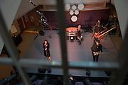 Baker Center Dedication.MASS Ensemble:..Mass (music Archeitecture, Sonic, Sculptue) Perform the EARTH HARPS? The world's Largest String instrument? The Center Atrium is transformed...Andrea Brook, Harpest (blonde hair), Chrysta Bell (black hair), Vocals, Rich Sherwood, drums, Cameron Morgan, Guitar, Bill Close, Art director(short hair)