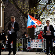 """April 7, 2016 - New York, NY : Protesters wave Puerto Rican flags and hold signs as they assemble outside the International House in Morningside Heights on Thursday afternoon, where Janet Yellen, Ben Bernanke, Alan Greenspan, and Paul Volcker were to participate in """"When the Federal Reserve Speaks...the World Listens,"""" an event hosted by <br /> International House New York. The protesters included members of Fed Up, a coalition which is advocating for Fed action to restructure Puerto Rico's debt. <br /> CREDIT: Karsten Moran for The New York Times"""