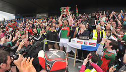 Mayo captain Keith Higgins lifts the Nestor Cup in Hyde Park after Mayo Connacht Final win over Sligo on sunday.<br /> Pic Conor McKeown