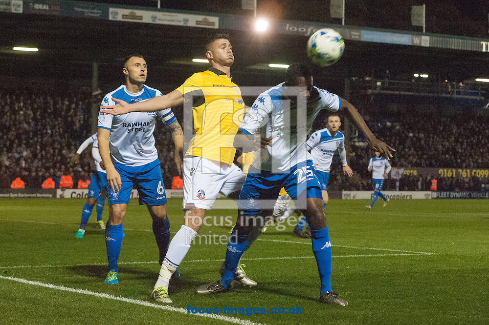Leon Barnett of Bury clears ahead of Gary Madine of Bolton Wanderers during the Sky Bet League 1 match at Gigg Lane, Bury<br /> Picture by Matt Wilkinson/Focus Images Ltd 07814 960751<br /> 24/10/2016