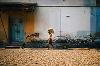 Fort Kochi, India -- February 12, 2018: A man carries bags of ginger at a spice market in Mattancherry.