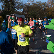 NYTRUN - NOV. 6, 2016 - NEW YORK - Participants in the 2016 TCS New York City Marathon pass through a water station near E 65th Street in Central Park on Sunday afternoon as they near the end of the course. NYTCREDIT:  Karsten Moran for The New York Times **PLS CHECK FINISH PLACE AND TIMES