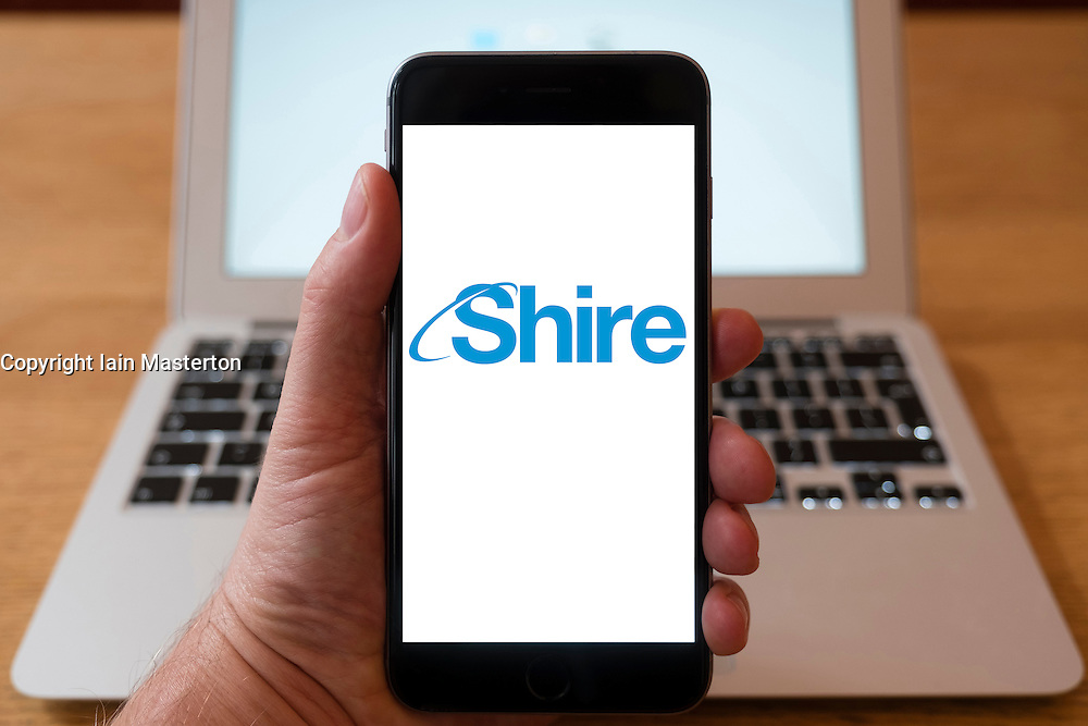 Using iPhone smartphone to display logo of Shire, a Biopharmaceutical company