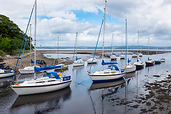 Boats moored on River Almond in Cramond outside Edinburgh in East Lothian, Scotland, united Kingdom