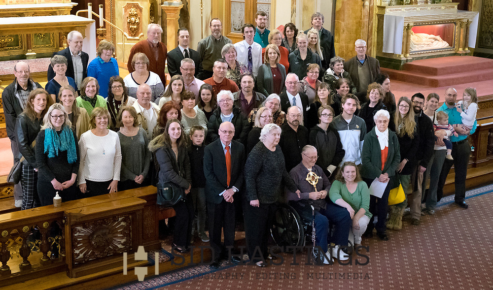 11 MARCH 2018 -- ST. LOUIS -- Descendants of German immigrant Ignatius Strecker pose for a photograph after Mass at the Shrine of St. Joseph Sunday, March 11, 2018 in the Columbus Square neighborhood of St. Louis. The group gathered to remember the healing of the Strecker, thought mortally ill, during an 1864 service honoring Jesuit priest Peter Claver, a missionary who worked among slaves in South America during the 17th century. Strecker's healing was among the miracles attributed to Claver that led to his 1888 canonization by Pope Leo XIII. Photo © copyright 2018 Sid Hastings.