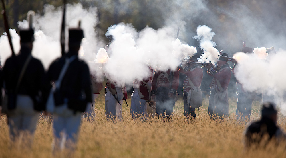 London, ONT.; October 1, 2011--  A line of British soldiers are obscured by smoke after firing on the Americans during a War of 1812 re-enactment at Fanshawe Pioneer Village in London, Ontario, October 1, 2011.<br /> <br /> (GEOFF ROBINS/ Postmedia News)