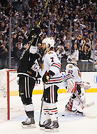The Kings' Dustin Brown celebrates his first period goal on Blackhawks' goaltender Corey Crawford as Brent Seabrook skates by during Game 4 of the Western Conference Final of the 2014 NHL Stanley Cup Playoffs at Staples Center Monday.