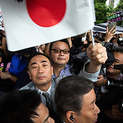 """TOKYO, JAPAN - JULY 1: Moritomo Gakuen head, Yasunori Kagoike (center), the academic organization linked to a land sale controversy that has engulfed Prime Minister Shinzo Abe and his wife Akie is surrounded by reporters as he arrives at election campaign of main opposition, Liberal Democratic Party (LDP) in Akihabara, Tokyo, Japan on July 1, 2017. During the election campaign for Tokyo Metropolitan Assembly, anti-Abe protesters gathers chanting """"Abe wa Yamero!"""" """"Resign Prime Minister Abe!"""" during the campaign speech of PM Shinzo Abe and her candidate Aya Nakamura. (Photo: Richard Atrero de Guzman/NUR Photo)"""