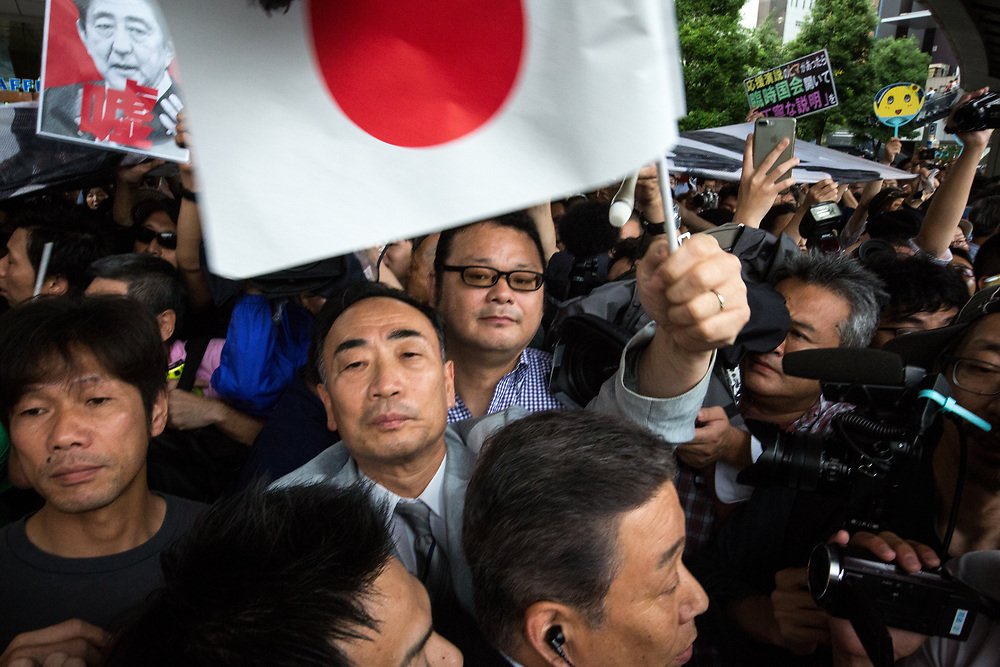 "TOKYO, JAPAN - JULY 1: Moritomo Gakuen head, Yasunori Kagoike (center), the academic organization linked to a land sale controversy that has engulfed Prime Minister Shinzo Abe and his wife Akie is surrounded by reporters as he arrives at election campaign of main opposition, Liberal Democratic Party (LDP) in Akihabara, Tokyo, Japan on July 1, 2017. During the election campaign for Tokyo Metropolitan Assembly, anti-Abe protesters gathers chanting ""Abe wa Yamero!"" ""Resign Prime Minister Abe!"" during the campaign speech of PM Shinzo Abe and her candidate Aya Nakamura. (Photo: Richard Atrero de Guzman/NUR Photo)"