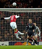 Photo: Ed Godden.<br /> Arsenal v CSKA Moscow. UEFA Champions League, Group G. 01/11/2006. Arsenal's Robin Van Persie heads the ball over the bar.