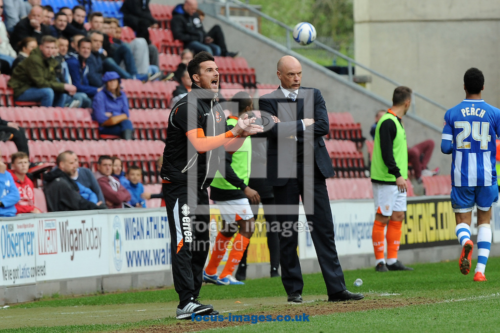 Barry Ferguson, manager of Blackpool shouts instructions to his players during the Sky Bet Championship match against Wigan Athletic at the DW Stadium, Wigan.<br /> Picture by Alan Wright/Focus Images Ltd 07733 196489<br /> 26/04/2014