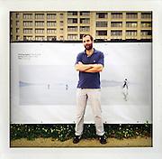 PHOTOVILLE, Brooklyn, New York, June 2012.Photographer Dirk Anschuetz in front of his work at PHOTOVILLE..© Stefan Falke.www.stefanfalke.com..