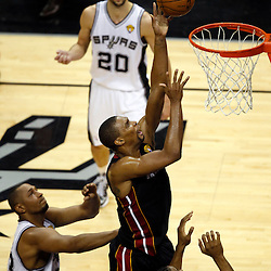 Jun 16, 2013; San Antonio, TX, USA; Miami Heat center Chris Bosh (1) shoots against the San Antonio Spurs during the second quarter of game five in the 2013 NBA Finals at the AT&T Center. Mandatory Credit: Derick E. Hingle-USA TODAY Sports