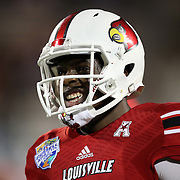 Louisville Cardinals quarterback Teddy Bridgewater (5) is seen during warmups prior to the NCAA Football Russell Athletic Bowl football game between the Louisville Cardinals and the Miami Hurricanes, at the Florida Citrus Bowl on Saturday, December 28, 2013 in Orlando, Florida. (AP Photo/Alex Menendez)