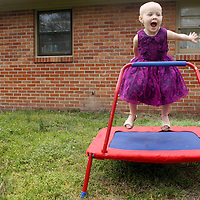 Holly Larue Frizzelle, 3 plays outsider her home in Wilmington, N.C. On December 27, 2012 two year old Holly Larue Frizzelle was diagnosed with Acute Lymphoblastic Leukemia. What began as a stomach ache and visit to her regular pediatrician led to a hospital admission, transport to the University of North Carolina Children's Hospital, and more than two years of treatment.