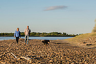 Kevin and Karen Boehler, dog Zac, evening walk on their farm, Yellowstone River, east of Fairview Montana, near its confluence with the Missouri