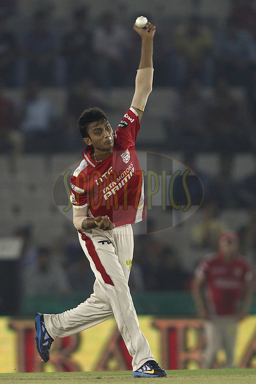 Akshar Patel of the Kings XI Punjab sends down a delivery during match 2 of the Oppo Champions League Twenty20 between the Kings XI Punjab and the Hobart Hurricanes held at the Punjab Cricket Association Stadium, Mohali, India on the 18th September 2014<br /> <br /> Photo by:  Shaun Roy / Sportzpics/ CLT20<br /> <br /> <br /> Image use is subject to the terms and conditions as laid out by the BCCI/ CLT20.  The terms and conditions can be downloaded here:<br /> <br /> http://sportzpics.photoshelter.com/gallery/CLT20-Image-Terms-and-Conditions-2014/G0000IfNJn535VPU/C0000QhhKadWcjYs