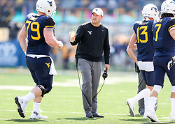 Sep 16, 2017; Morgantown, WV, USA; West Virginia Mountaineers offensive coordinator Jake Spavital celebrates with players after scoring a touchdown during the first quarter against the Delaware State Hornets at Milan Puskar Stadium. Mandatory Credit: Ben Queen-USA TODAY Sports