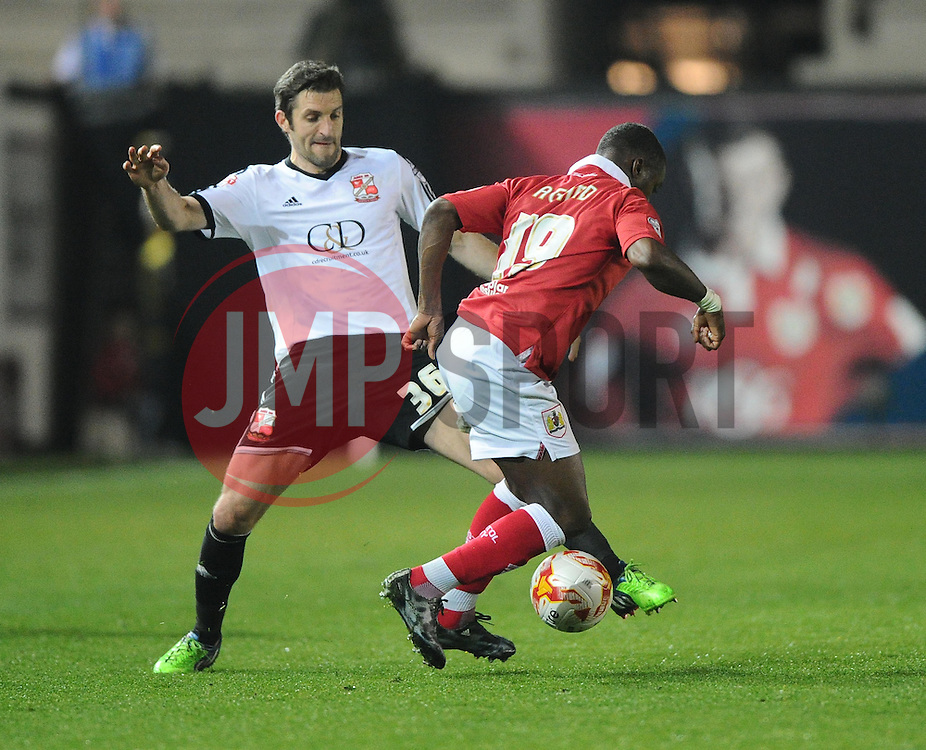 Bristol City's Kieran Agard battles for the ball with Swindon Town's Sam Ricketts  - Photo mandatory by-line: Joe Meredith/JMP - Mobile: 07966 386802 - 07/04/2015 - SPORT - Football - Bristol - Ashton Gate - Bristol City v Swindon Town - Sky Bet League One