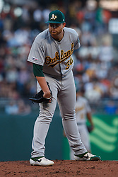 SAN FRANCISCO, CA - AUGUST 13: Brett Anderson #30 of the Oakland Athletics stands on the pitchers mound against the San Francisco Giants during the first inning at Oracle Park on August 13, 2019 in San Francisco, California. The San Francisco Giants defeated the Oakland Athletics 3-2. (Photo by Jason O. Watson/Getty Images) *** Local Caption *** Brett Anderson