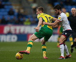 Marco Stiepermann of Norwich City (L) and Jason Lowe of Bolton Wanderers in action - Mandatory by-line: Jack Phillips/JMP - 16/02/2019 - FOOTBALL - University of Bolton Stadium - Bolton, England - Bolton Wanderers v Norwich City - English Football League Championship