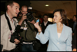 Prime minister's wife Cherie Blair offers a photographer a condom as she tours the exhibition stands in the conference centre in Brighton during the Labour Party conference today 28 September 2005. PA Photo.
