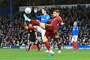 Ryan Williams (7) of Portsmouth battles for possession with Luke Garbutt (29) of Ipswich Town during the EFL Sky Bet League 1 match between Portsmouth and Ipswich Town at Fratton Park, Portsmouth, England on 21 December 2019.