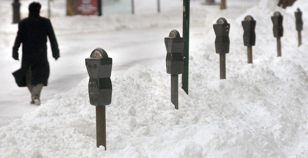 Parking meters are seen covered by large snow drifts following a major winter storm in Brooklyn, NY Sunday, 23 January 2005. The storm dumped over a foot of snow, over two in some places, on the Eastern United States, causing nearly 500 flights to be canceled Sunday morning at the New York metropolitan area's Newark, Kennedy and LaGuardia airports.