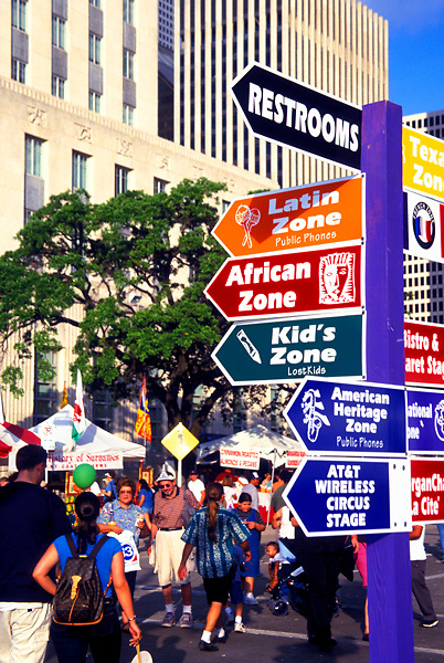 Stock photo of a navigational sign in the street at the International Festival in downtown Houston Texas