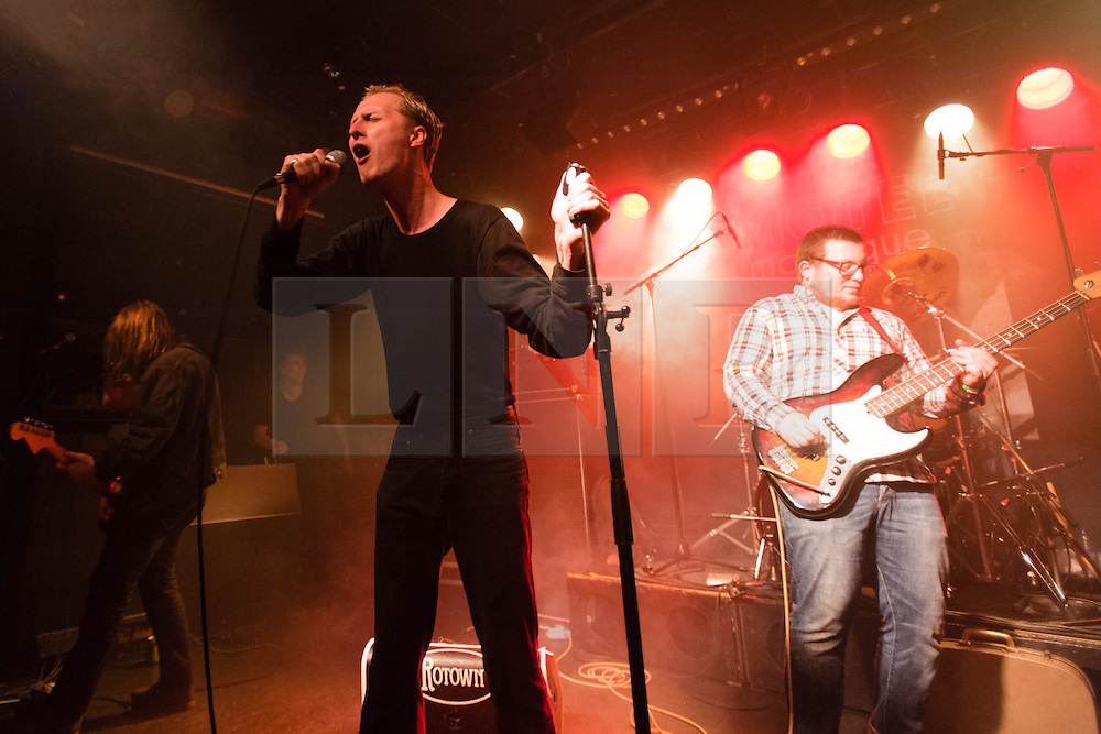 © Licensed to London News Pictures. 04/04/2014. Rotterdam, Netherlands.   Eagulls performing live at Motel Mozaique Festival.  In this picture - George Mitchell (centre), Liam Matthews (left), Tom Kelly (right).  Eagulls are an English post-punk band from Leeds, England, consisting of Mark Goldsworthy (guitar), Henry Ruddel (drums), Liam Matthews (guitar), Tom Kelly (bass), and George Mitchell (vocals).  Eagulls performed on the american tv show Letterman in January and have been receiving excellent reviews for their eponymous debut album.  Motel Mozaïque is an annual music/arts festival, held annually in Rotterdam, Netherlands.  Photo credit : Richard Isaac/LNP