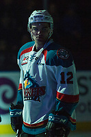 KELOWNA, CANADA - FEBRUARY 14: Erik Gardiner #12 of the Kelowna Rockets stands in the spotlight and lines up against the Red Deer Rebels  on February 14, 2018 at Prospera Place in Kelowna, British Columbia, Canada.  (Photo by Marissa Baecker/Shoot the Breeze)  *** Local Caption ***