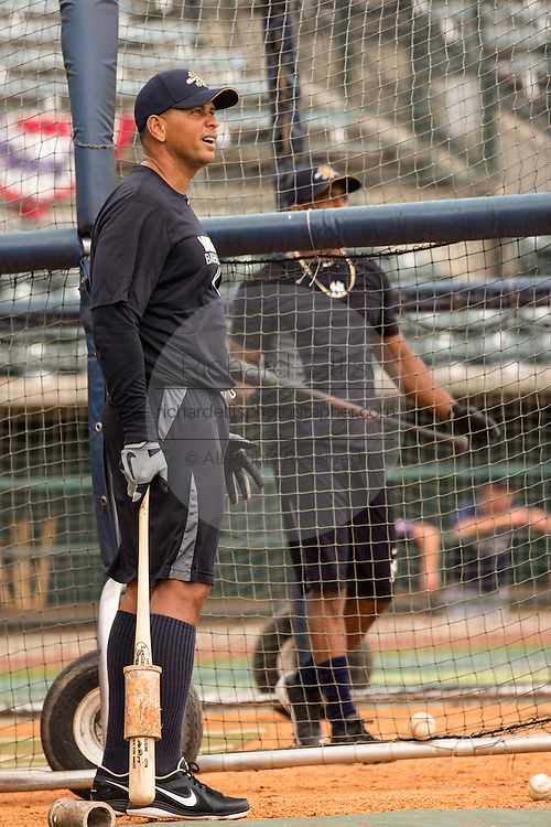 New York Yankees Alex Rodriguez watches a ball hit by teammate Eduardo Nunez during batting practice before appearing in the first game since hip surgery with the minor league Charleston RiverDogs at Joseph P. Riley Jr. Stadium July 2, 2013 in Charleston, South Carolina.