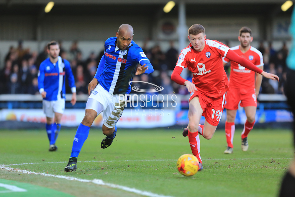 Calvin Andrew and Dion Donohue race for the ball during the EFL Sky Bet League 1 match between Rochdale and Chesterfield at Spotland, Rochdale, England on 26 December 2016. Photo by Daniel Youngs.