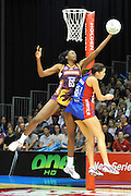 Romelda Aiken secures the incoming ball for the Firebirds ~ Netball action from ANZ Championship Grand Final - Queensland Firebirds v Northern Mystics - played at the Brisbane Convention Centre on Sunday 22nd May 2011 ~ Photo : Steven Hight (AURA Images) / Photosport
