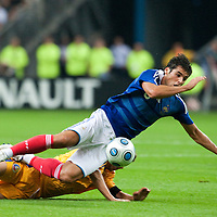 05 September 2009: French forward Yoann Gourcuff  is tackled by Romanian player Maximilian Nicu during the World Cup 2010 qualifying football match France vs. Romania (1-1), on September 5, 2009 at the Stade de France stadium in Saint-Denis, near Paris, France.