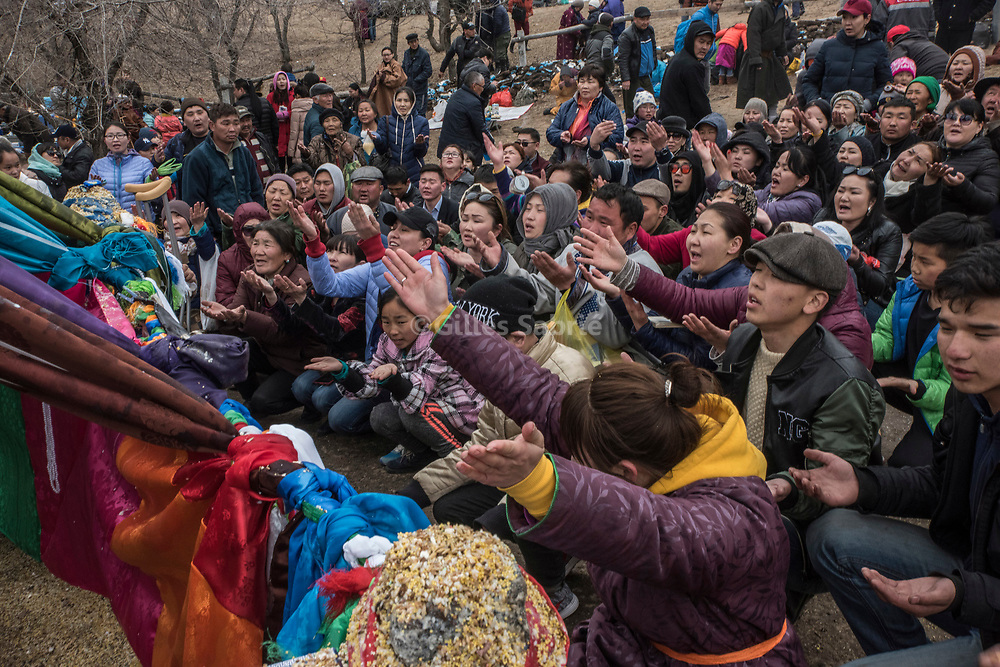 S&uuml;khbaatar, MONGOLIA, April 4th 2017<br /> Shaman believers gathered around a the mother tree, in prayers their palms to the sky during a celebration of spring.<br />  Gilles Sabri&eacute; for 1843