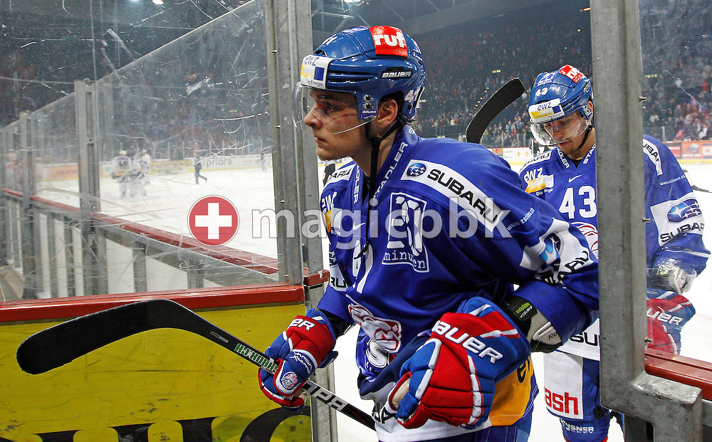 ZSC Lions forward Chris Baltisberger (L) and defender John Gobbi on their way to the lockers after after the first third in the ice hockey game two of the Swiss National League A (Season 2011-2012) Playoff Final between ZSC Lions (ZSC) and SC Bern (SCB) held at the Hallenstadion in Zurich, Switzerland, Thursday, April 5, 2012. (Photo by Patrick B. Kraemer / MAGICPBK)