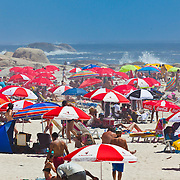 Holiday time on the beach at Camps Bay, Cape Town area, South Africa.