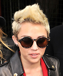 (UK RIGHTS ONLY) Miley Cyrus wearing a black leather bikers jacket, red suit leaving Rachel Zoe Fall 2013 fashion show during Mercedes-Benz Fashion Week at The Studio, Lincoln Center in New York City., USA. 13/02/2013<br /> BYLINE MUST READ : EAGLEPRESS/GOTCHA IMAGES<br /> <br /> Copyright by © Gotcha Images Ltd. All rights reserved.<br /> Usage of this image is conditional upon the acceptance <br /> of Gotcha Images Ltd, terms and conditions available at<br /> www.gotchaimages.com