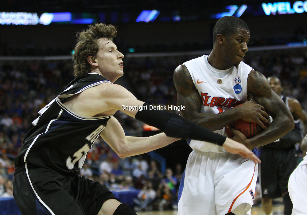 Mar 26, 2011; New Orleans, LA; Florida Gators guard Kenny Boynton (1) is defended by Butler Bulldogs forward Matt Howard (54) during the first half of the semifinals of the southeast regional of the 2011 NCAA men's basketball tournament at New Orleans Arena.   Mandatory Credit: Derick E. Hingle