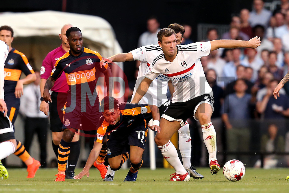 Ayoze Perez of Newcastle United is pushed off the ball by Kevin McDonald of Fulham - Mandatory by-line: Robbie Stephenson/JMP - 05/08/2016 - FOOTBALL - Craven Cottage - Fulham, England - Fulham v Newcastle United - Sky Bet Championship