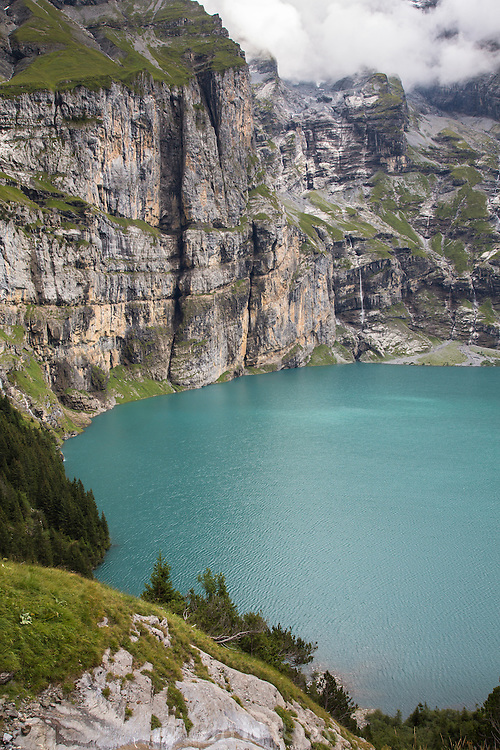 Glacier-fed waterfalls above Oeschinensee Lake, Via Alpina, Swiss Alps
