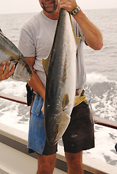 Sport fisherman holding a tuna