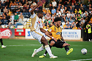 MKDons forward Chucks Aneke (10) can't convert this cross closely shadowed by Cambridge United's Louis John(25) during the EFL Sky Bet League 2 match between Cambridge United and Milton Keynes Dons at the Cambs Glass Stadium, Cambridge, England on 13 October 2018.