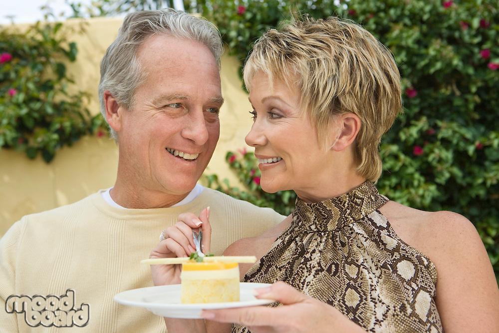 Couple sharing dessert outdoors
