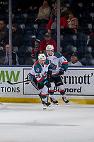 KELOWNA, CANADA - JANUARY 9: Lassi Thomson #2 hands the puck off to Kyle Crosbie #25 of the Kelowna Rockets against the Everett Silvertips on January 9, 2019 at Prospera Place in Kelowna, British Columbia, Canada.  (Photo by Marissa Baecker/Shoot the Breeze)